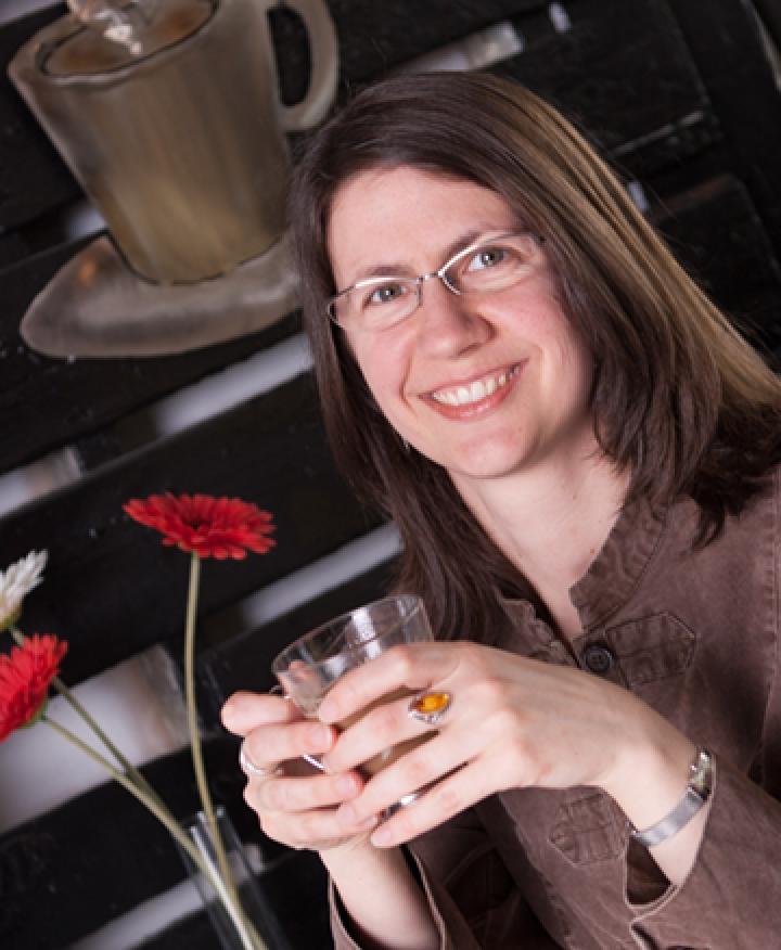 Liz Sousa - Designer.